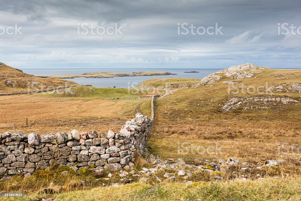 Highlands, Scotland. Sea, dry-stone wall and islands near Durness stock photo