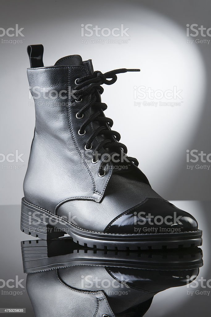 highlight on a womens black boot royalty-free stock photo