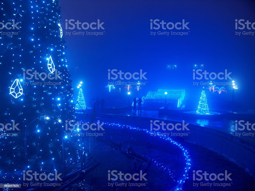 Highlighted artifical Christmas tree stock photo