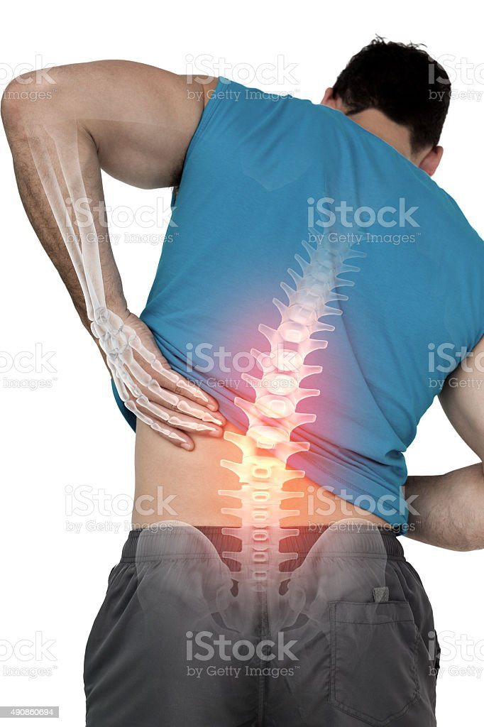 Highlighted back pain of fit man stock photo