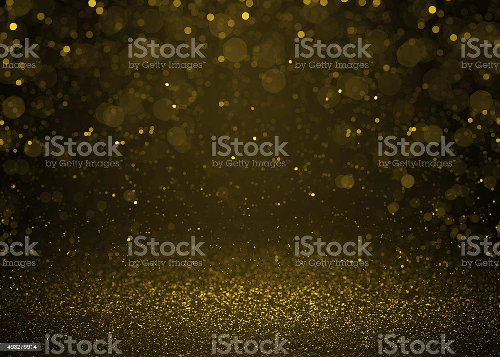 Highlighted bokeh gold sparkle glitter background stock photo