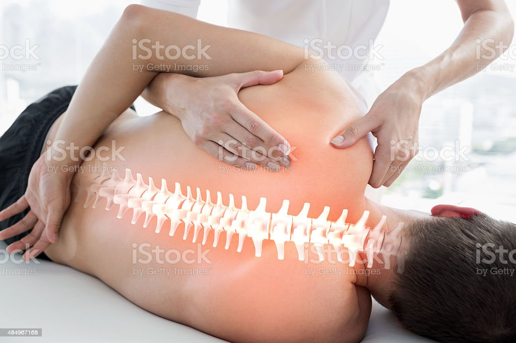 Highlighted bones of man at physiotherapy stock photo