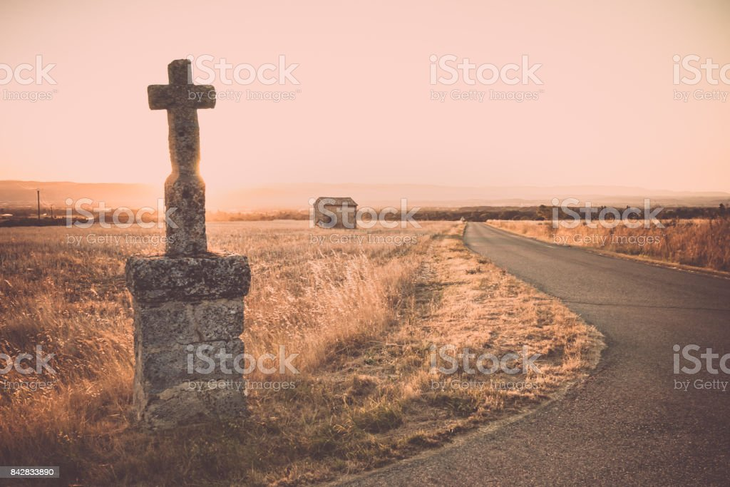 Highlighted cross memorial monument along the side of the road stock photo