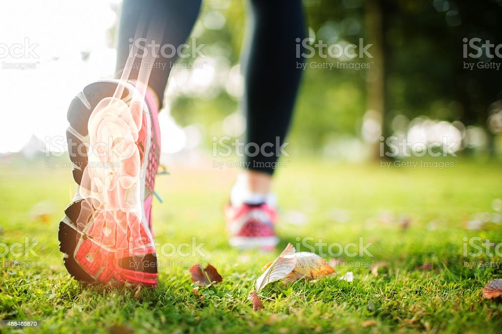 Highlighted foot bones of jogging woman stock photo
