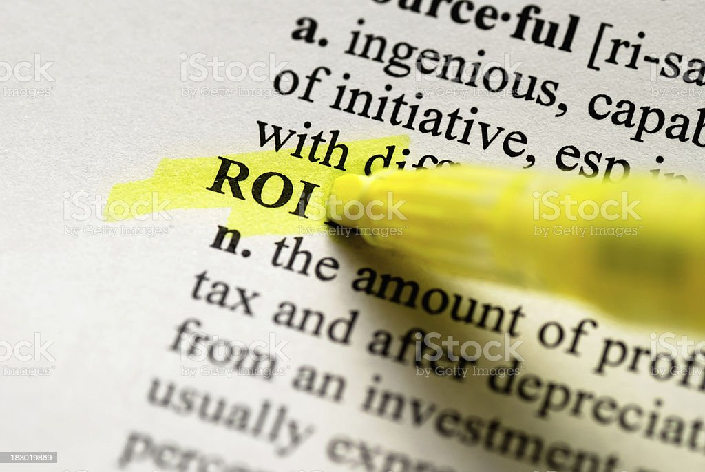 ROI Highlighted in Dictionary stock photo