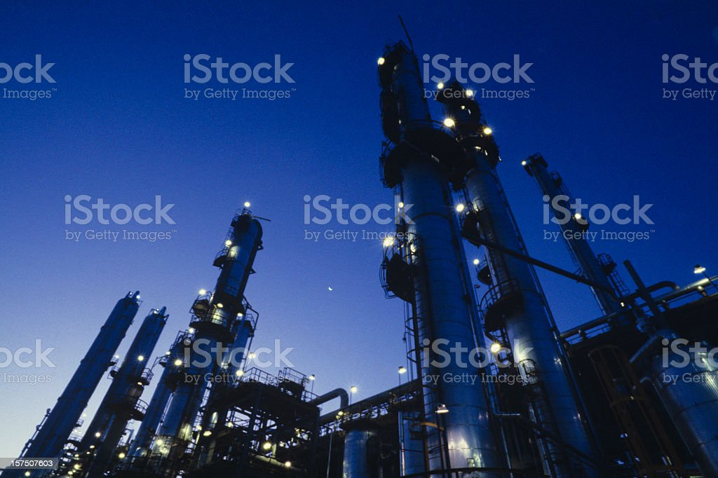Highlighting the lights on a refinery at night stock photo