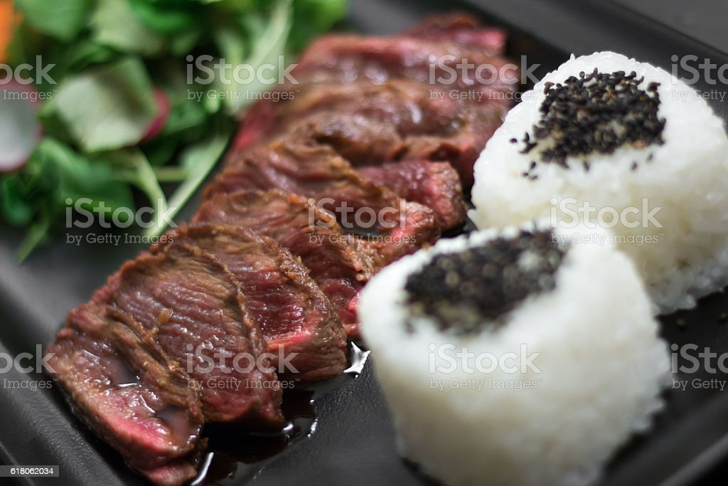 High-quality beef wih rice and salad stock photo