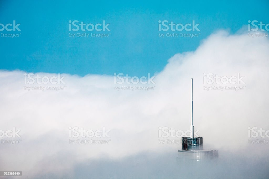 Highrise building surrounded by clouds. Chicago. stock photo