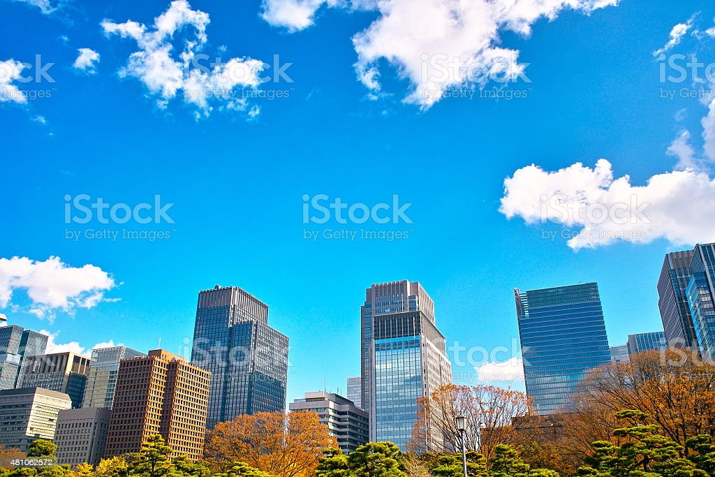 High-rise buildings and blue sky of autumn stock photo