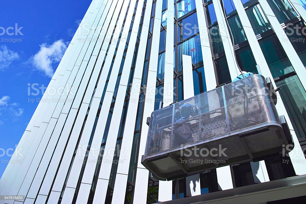 High-rise buildings of the window glass during the cleaning stock photo