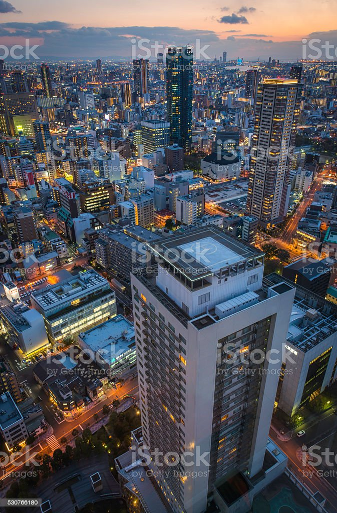 Highrise city futuristic neon skyscrapers urban highways illuminated at sunset stock photo