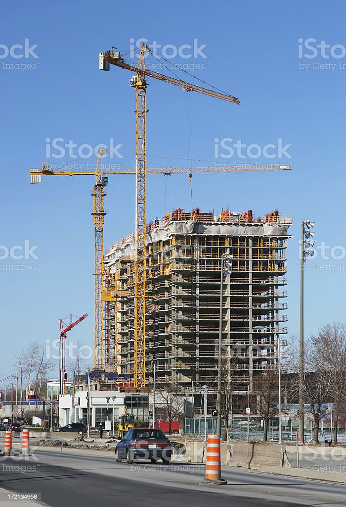Highrise Construction Building and Cranes royalty-free stock photo