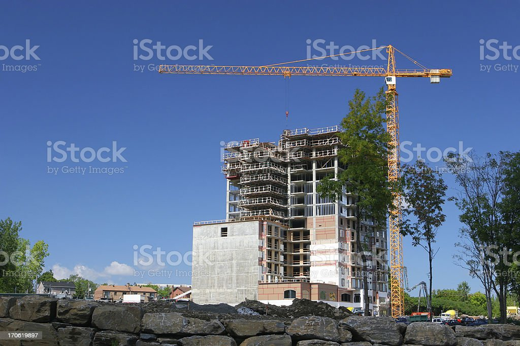 Highrise Construction Site and Crane royalty-free stock photo