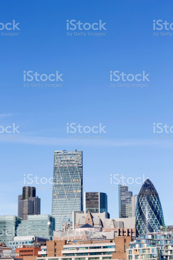 High-rise of the City of London against a blue sky stock photo