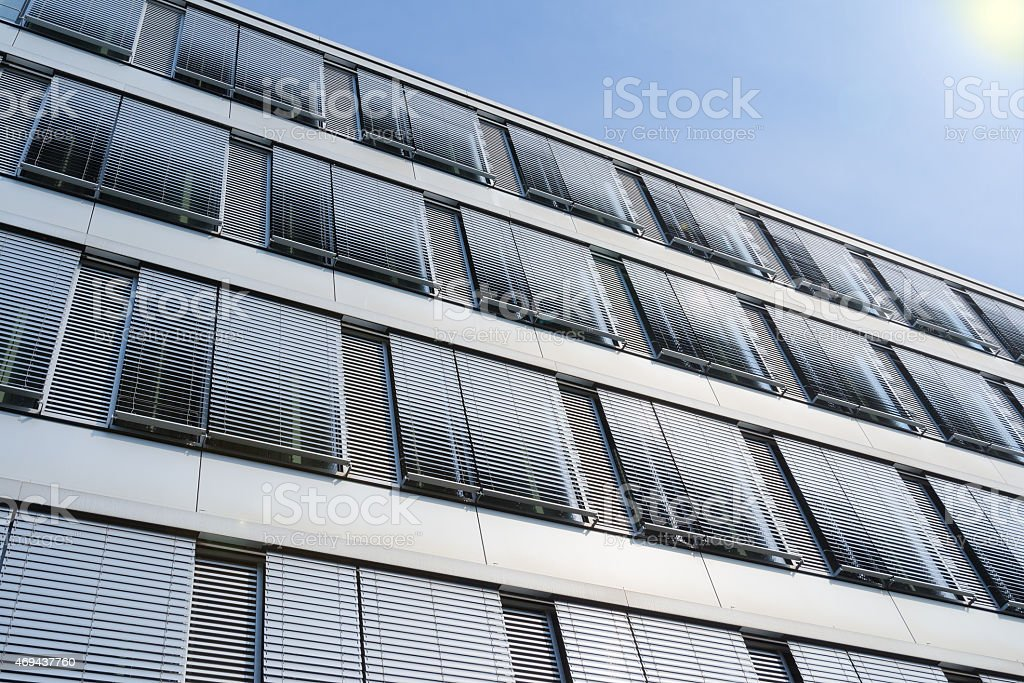 High-rise office building facade with covered windows Venetian b stock photo