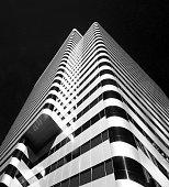 Highrise Skyscraper, Modern Futuristic Facaid, Black/White Portrait Format, Dutch Angle