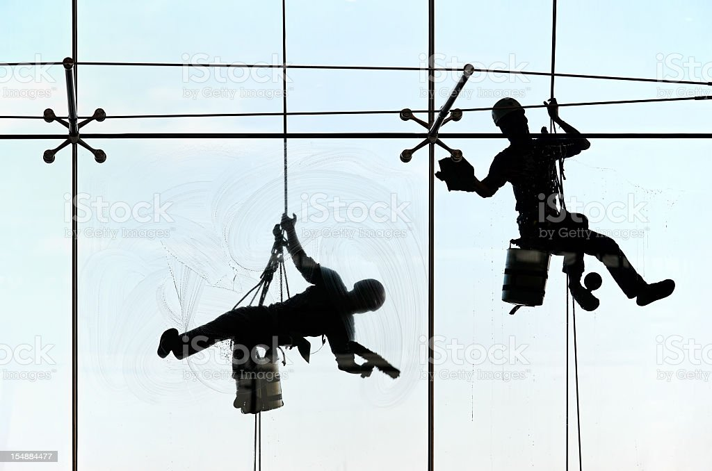 High-rise window cleaners. stock photo