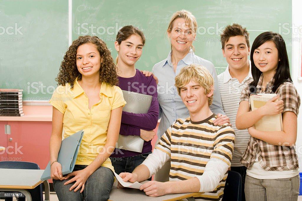High-school classmates and teacher stock photo