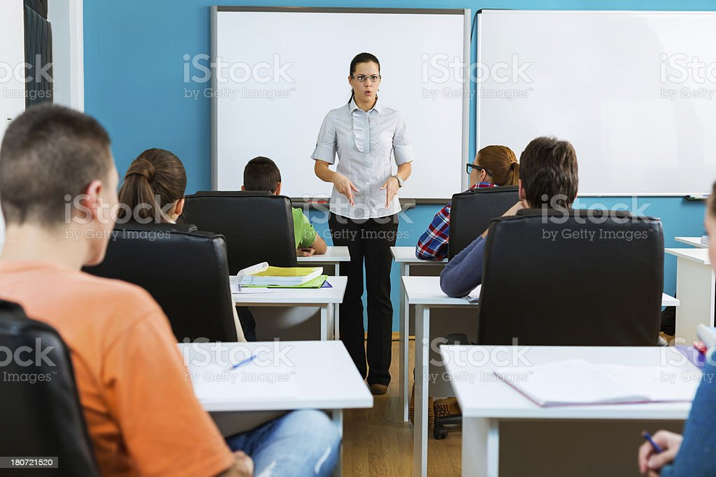 Highschool students and teacher in the classroom royalty-free stock photo
