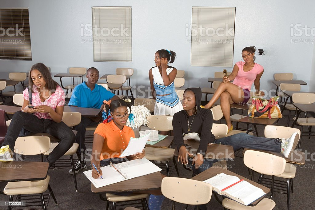 Highschool students messing in class during break royalty-free stock photo