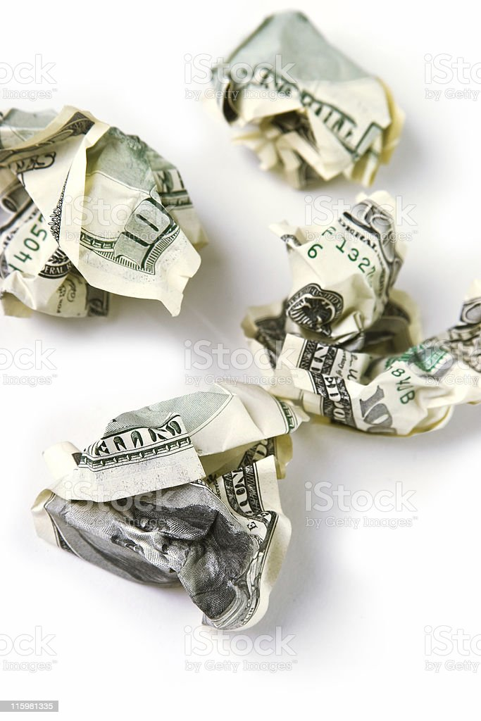 Hight taxes. Crinkly dollar banknoted isolated on white royalty-free stock photo