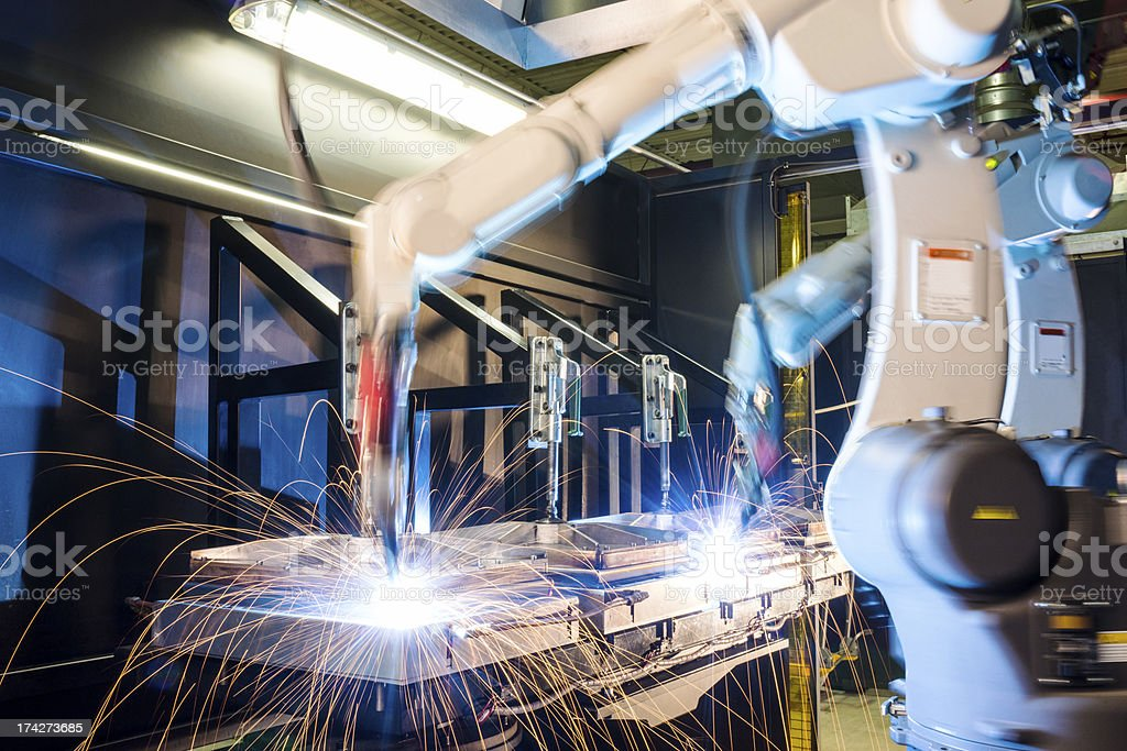 High-tech, industrial robotic welding machines stock photo