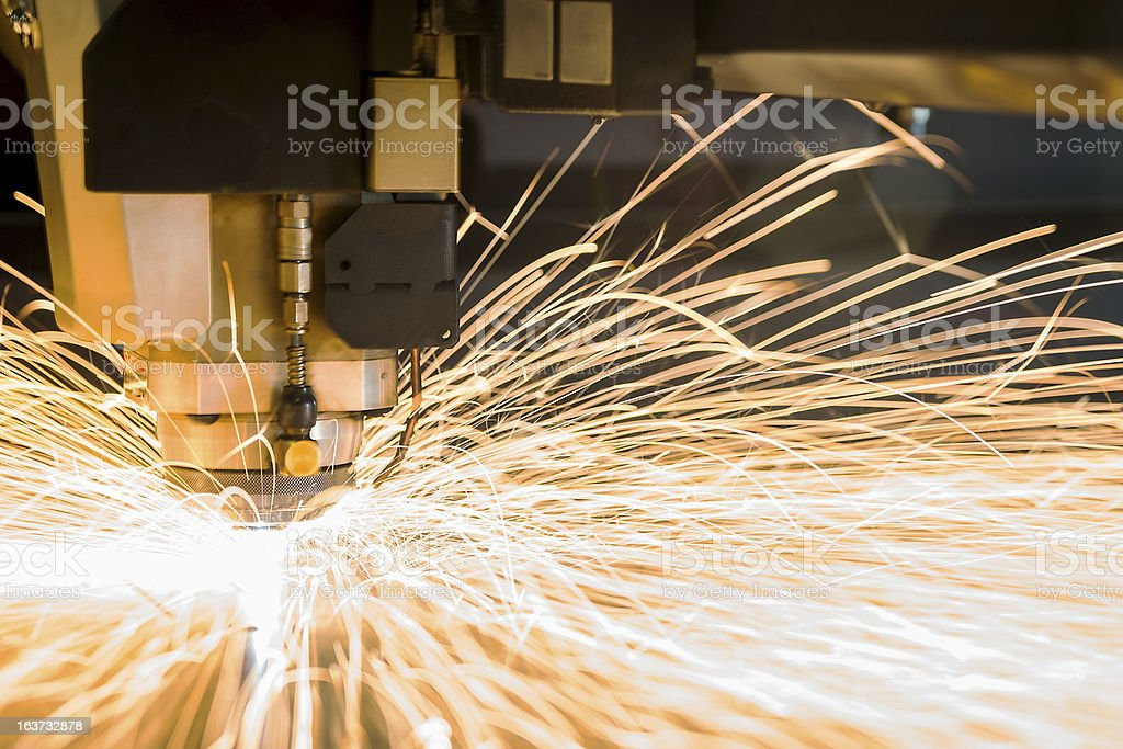 High-tech metal CNC, cutting laser tool in use. stock photo