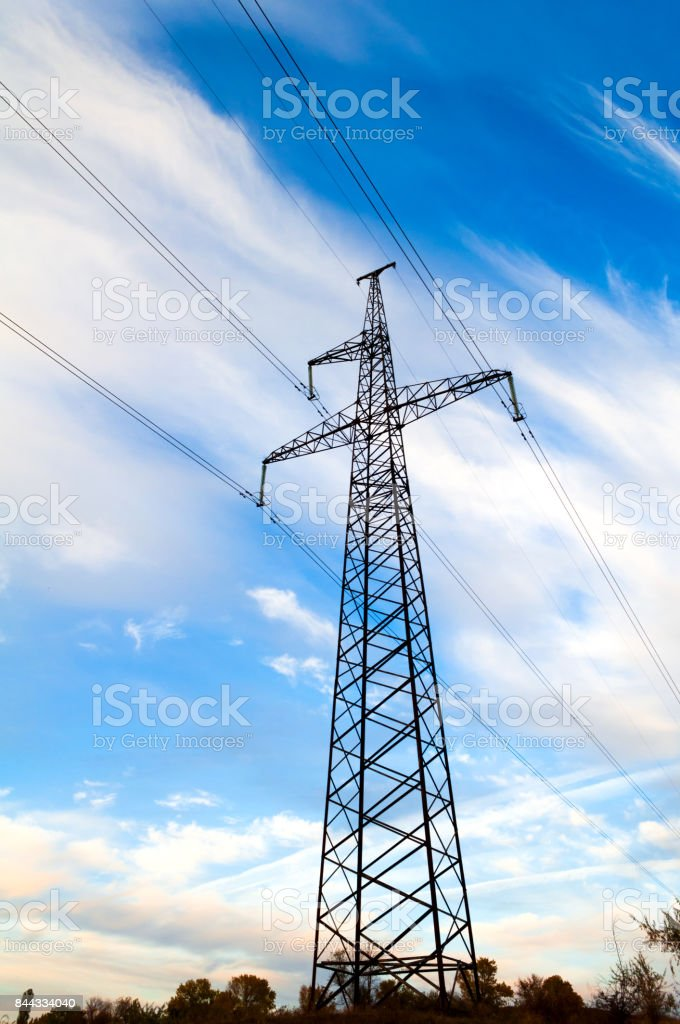 high-voltage post on a background of sky stock photo