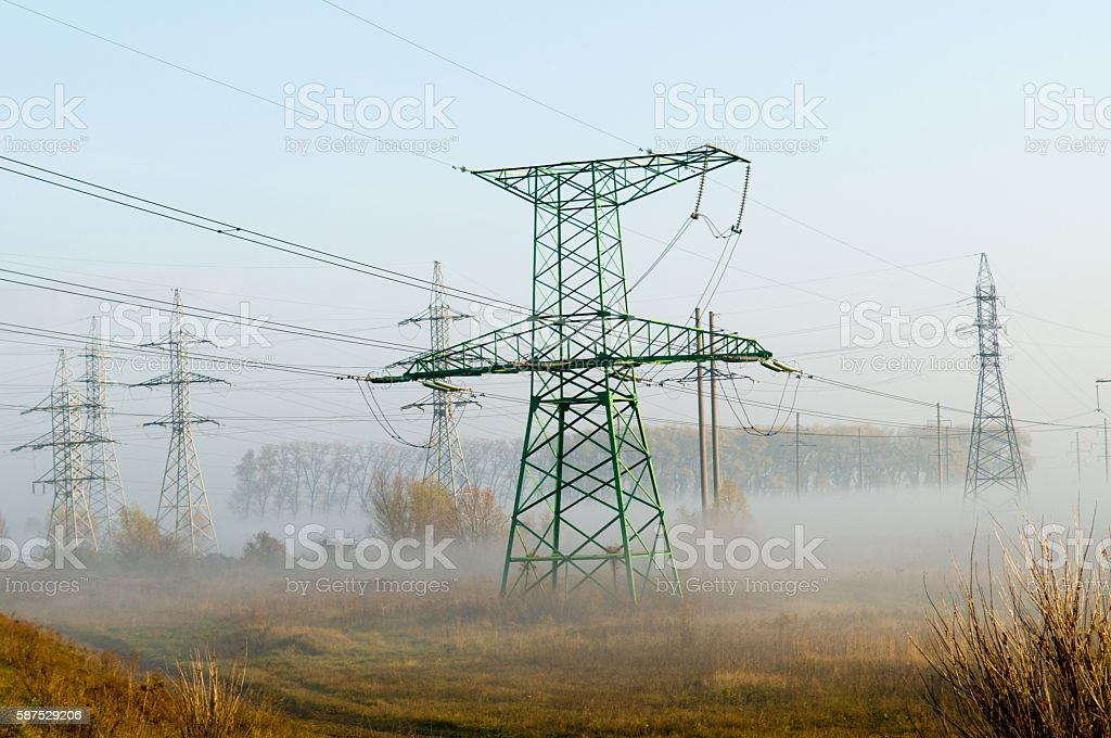 High-voltage power line against the autumn landscape stock photo
