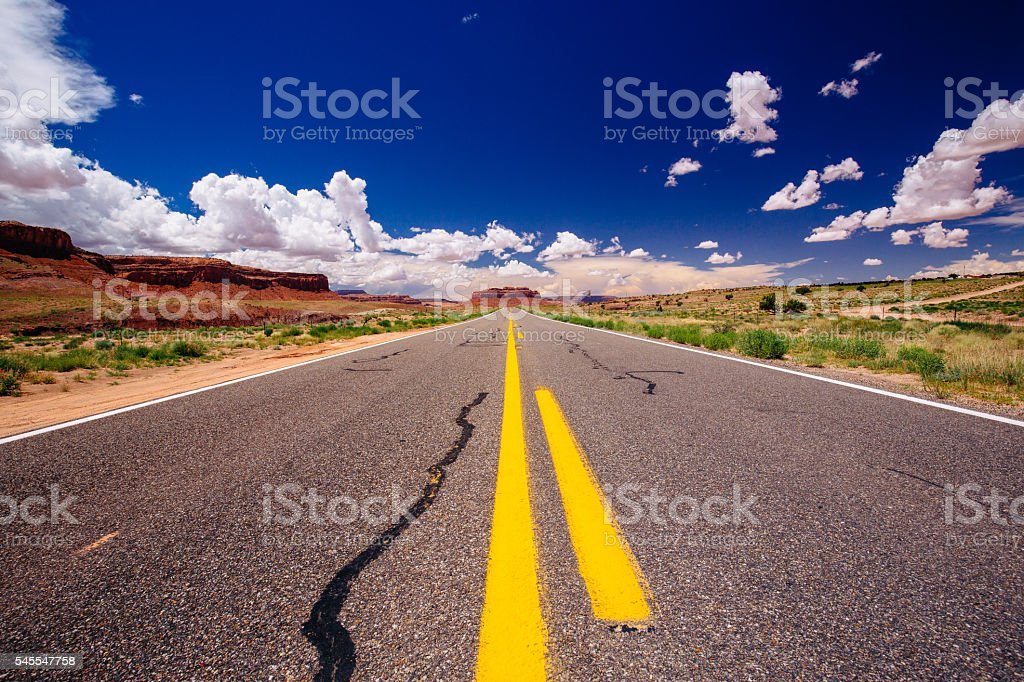 Highway 163, an endless road, Agathla Peak, Arizona, USA stock photo