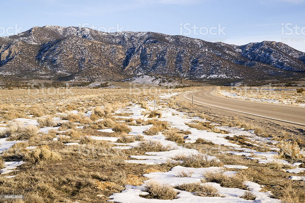 Highway 93 Great Basin HWY Cuts into Nevada Mountain Landscape stock photo