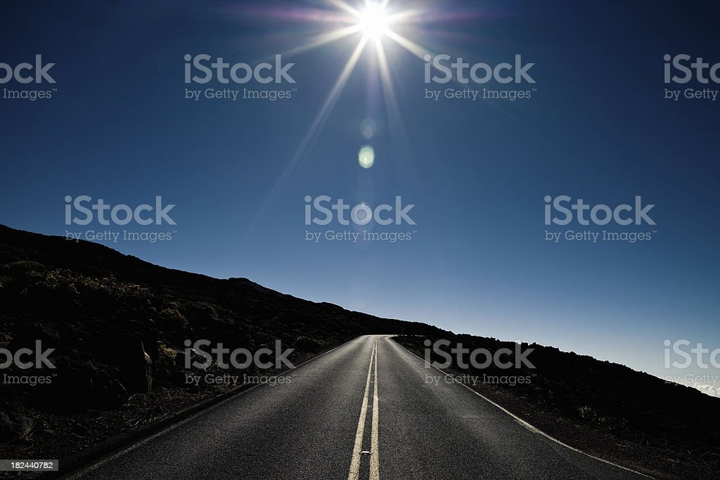 Highway Against the Sun Maui Hawaii royalty-free stock photo