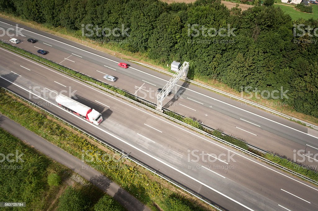 Highway and control gantry - aerial view stock photo