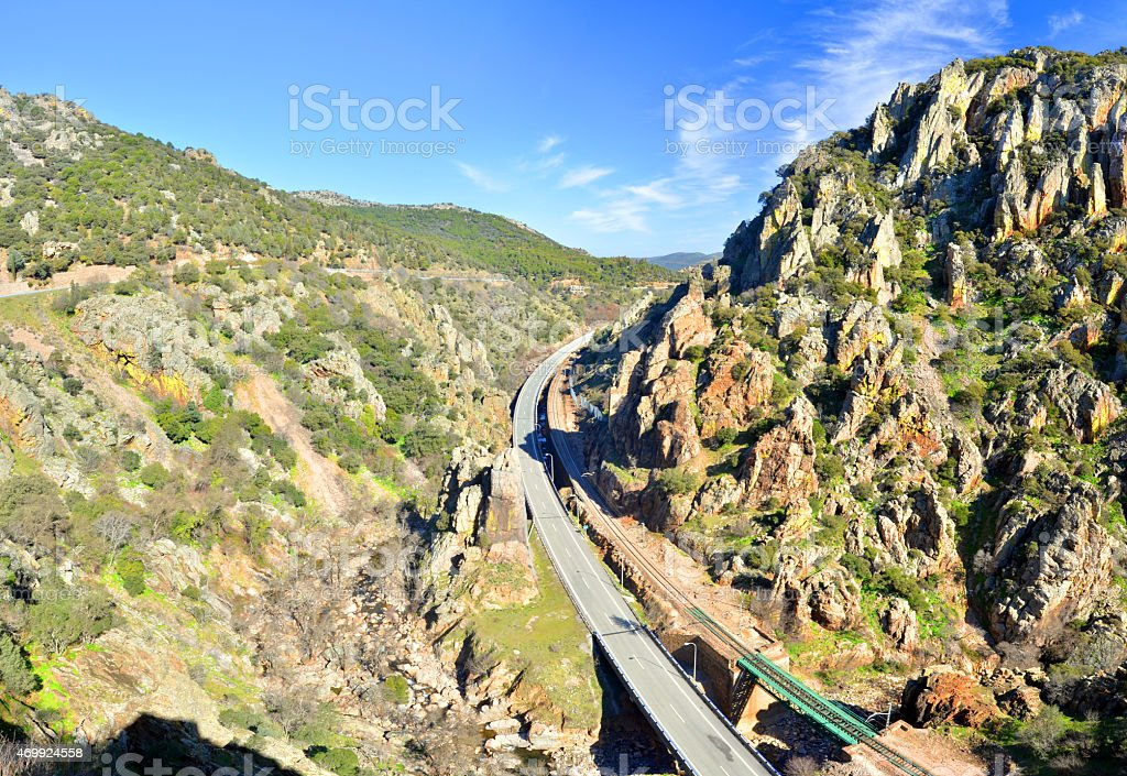 Highway and railway crossing Despenaperros national park in Northern Andalusia stock photo