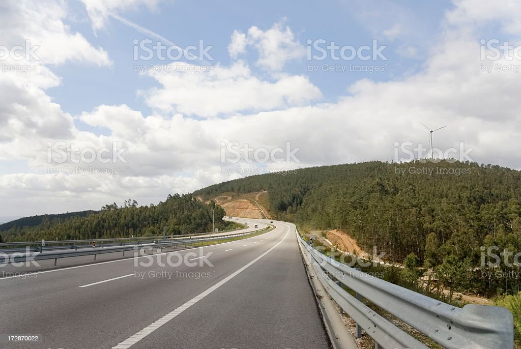 Highway and Wind turbine royalty-free stock photo