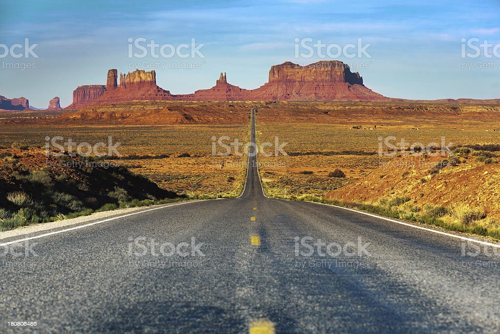 Highway Approaching Monument Valley in the American Southwest royalty-free stock photo