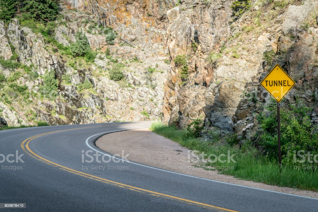 highway approaching tunnel in Poudre Canyon stock photo