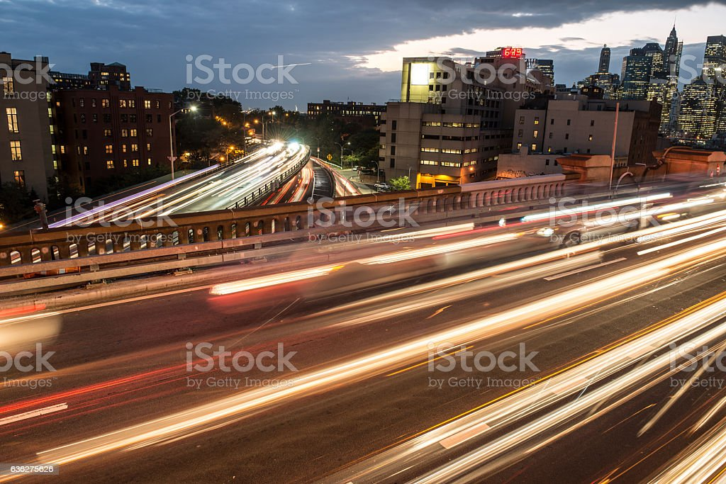 highway asphalt roads with night car traffic lights in city. stock photo