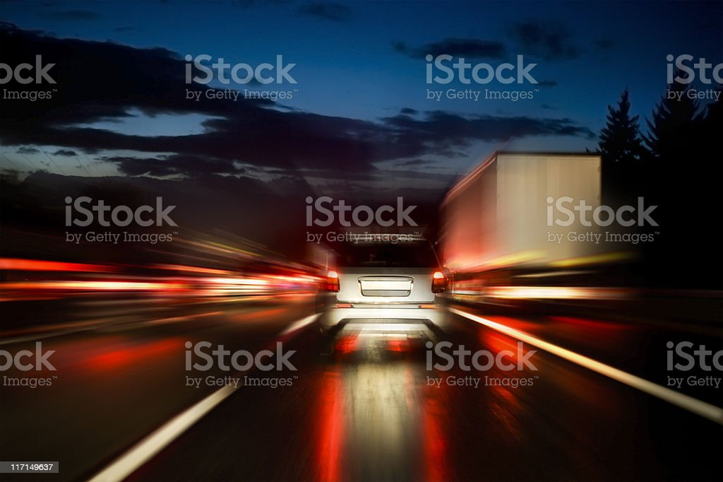 Highway at dusk, motion blur stock photo
