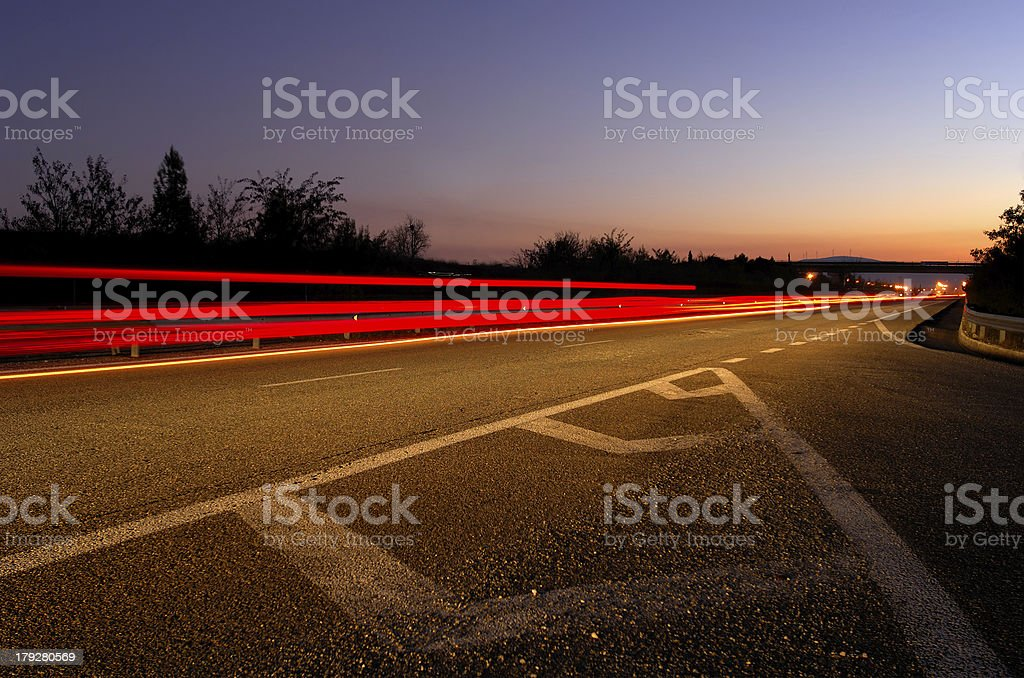 Highway at dusk royalty-free stock photo
