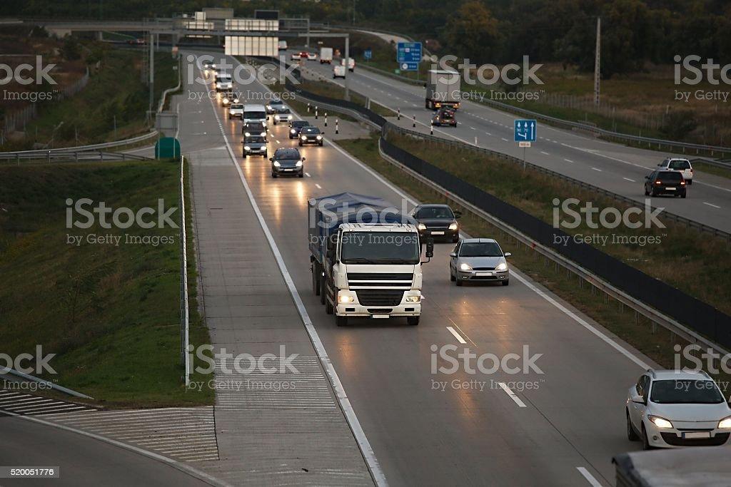 Highway at dusk stock photo