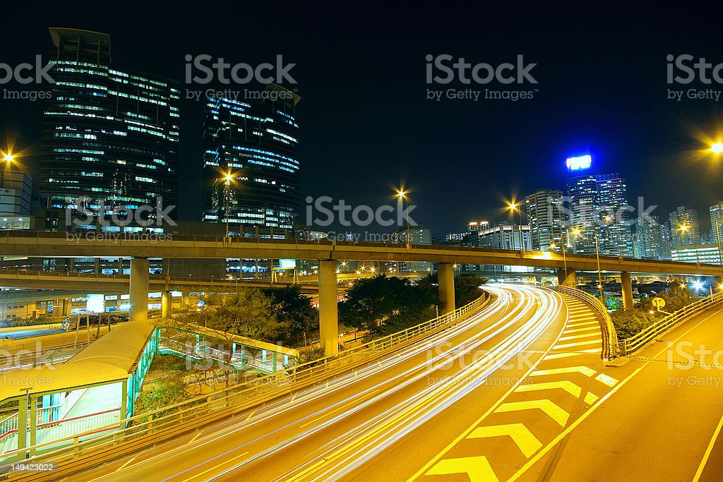 Highway at night in modern city royalty-free stock photo
