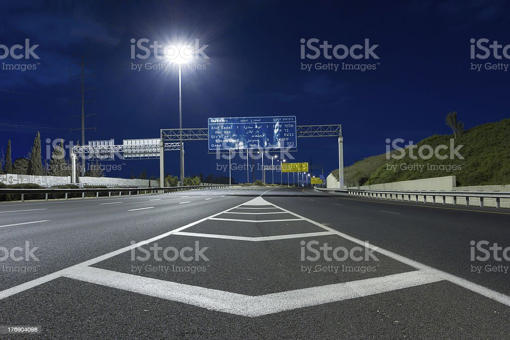 Highway at night. stock photo