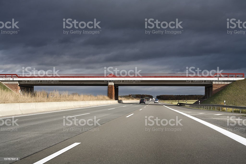 Highway / Autobahn, bridge - dark clouds royalty-free stock photo