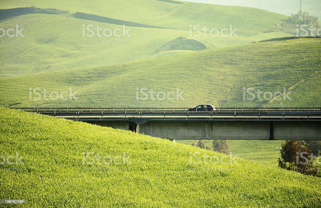 highway between fields royalty-free stock photo
