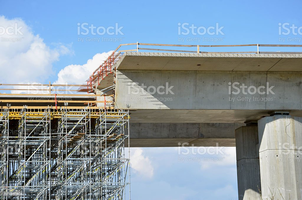Highway building process: building of carriageway over land on pillars stock photo