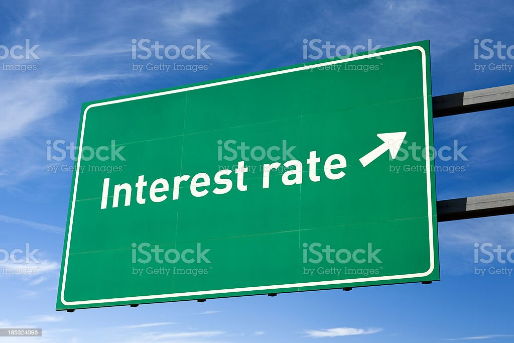 Highway directional sign for Interest rate stock photo