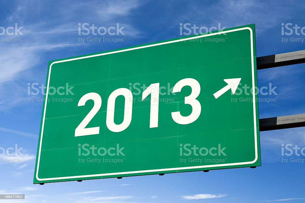 Highway directional sign for Year 2013 stock photo