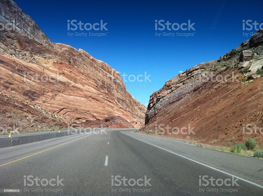 Highway dividing Rock Formations stock photo