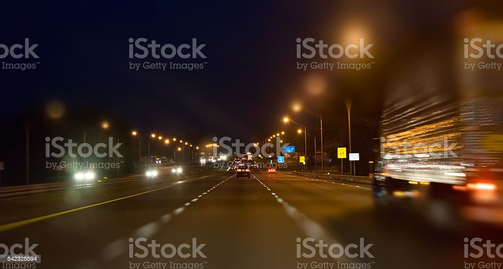 Highway Driving at Night stock photo